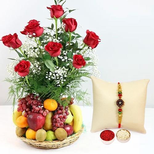 Exquisite Fresh Fruits Basket Hamper with Red Rose Bouquet with 1 Regular Rakhi and Roli Tilak Chawal