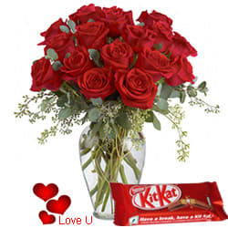 <u><font color=#008000> MidNight Delivery : </FONT></u>:Exclusive <font color =#FF0000> Dutch Red </font>   Roses  in Vase with free Cadburys Chocolate