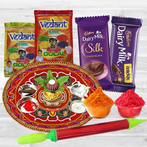 Colorful Holi Combo of Puja Thali with Herbal Gulal, Pichkari N Dairy Milk Chocolate