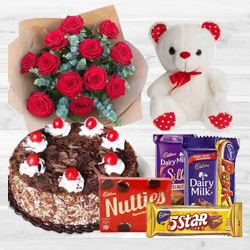Charming Bouquet of 12 Dutch Red Roses with 1 Lb Cake, Mixed Cadburys Chocolates and a Teddy Bear