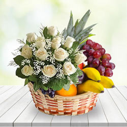 Touching Basketof Fresh Fruits with White Roses Bunch