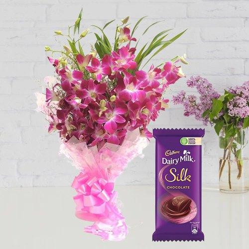 Send Bouquet of Orchids N Dairy Milk Silk Online