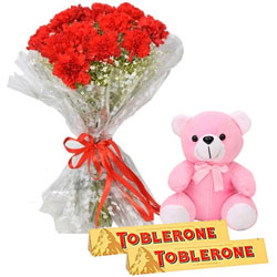 Exotic Red Carnation Bouquet with Toblerone Chocolate N Teddy