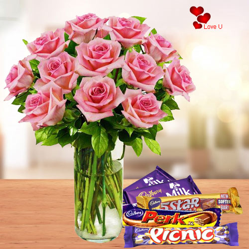 Send Rose Day Gift of Pink Roses in Vase with Assorted Chocolates