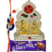 Silver Plated mandap with Golden Ganesh Laxmi Idol with Rakhi and Roli Tilak Chawal