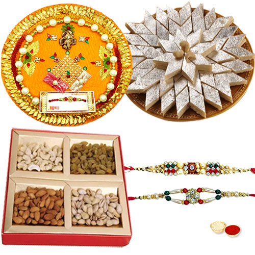 Exclusive Pooja thali with Kaju Katli, Dry Fruits and 2 free Rakhi, Roli Tika and Chawal