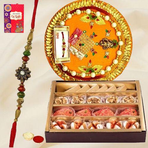 Assorted Sweets and Designer Pooja Thali along Rakhi, Roli, Tilak and Chawal