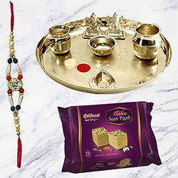 Soan Papri from Haldiram and Stylish and Trendy looking Silver Plated Paan Shaped Puja Aarti Thali (weight 52 gms) along Rakhi, Roli Tilak and Chawal