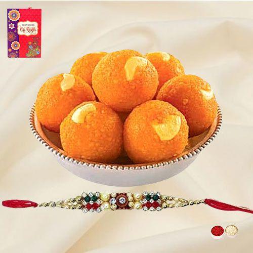 A Free Decorative Rakhi, Roli Tilak and Chawal with <font color=#FF0000>Haldiram</font> Pure Ghee Ladoo