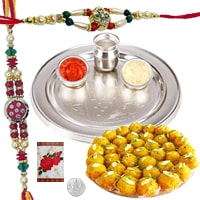 Enthralling 5 Inch. Silver Thali and 2 Fancy Rakhis with Assorted Sweets