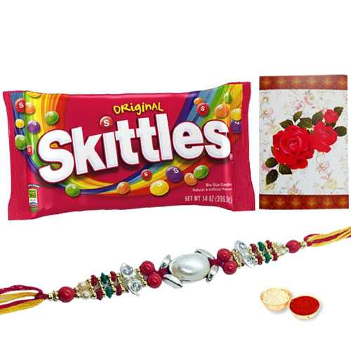 One or More Om/Ganesh Rakhi with Famous Skittles Chocolates Pack<br /><font color=#0000FF>Free Delivery in USA</font>
